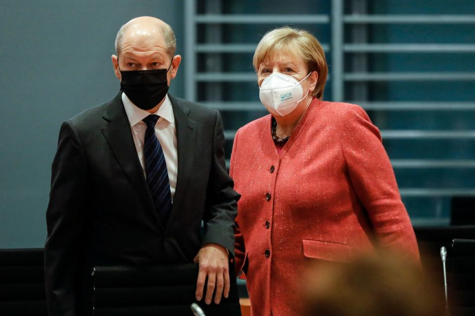 German Chancellor Angela Merkel (R) and German Finance Minister and Vice-Chancellor Olaf Scholz arrive for the weekly cabinet meeting of the German government at the chancellery in Berlin, Germany, on November 11, 2020. (Photo by Markus Schreiber / POOL / AFP) (Photo by MARKUS SCHREIBER/POOL/AFP via Getty Images)