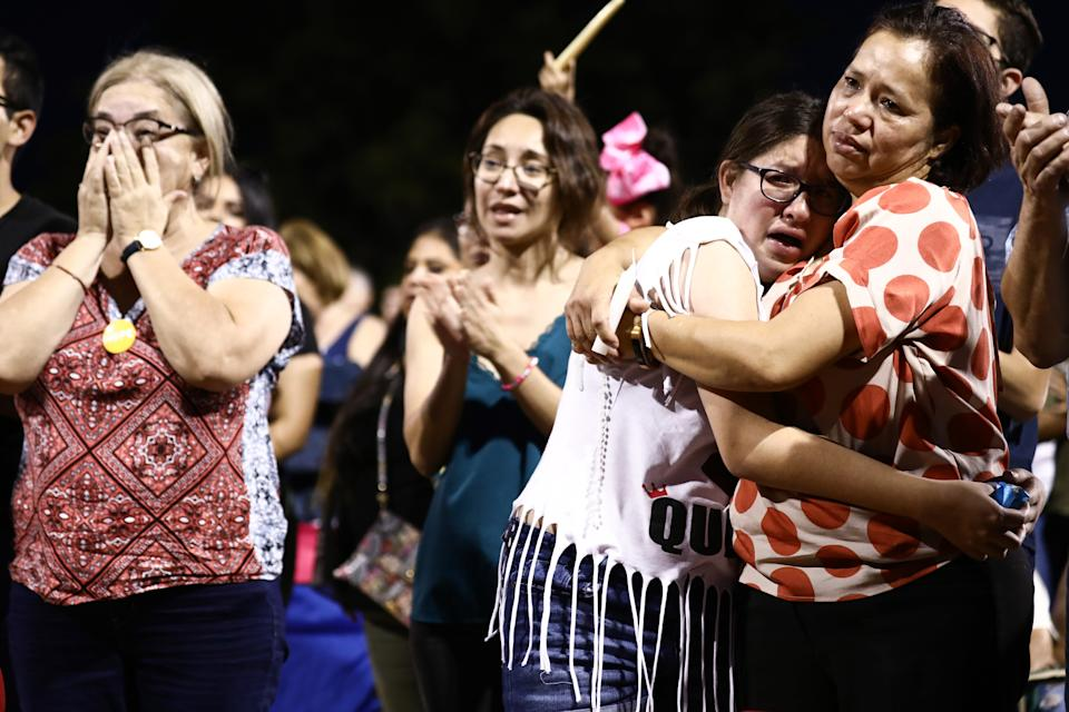 El Paso residents embrace at an interfaith vigil for victims of a mass shooting which left over 20 people dead. How hospitals prepare for the worst. (Photo by Mario Tama/Getty Images)