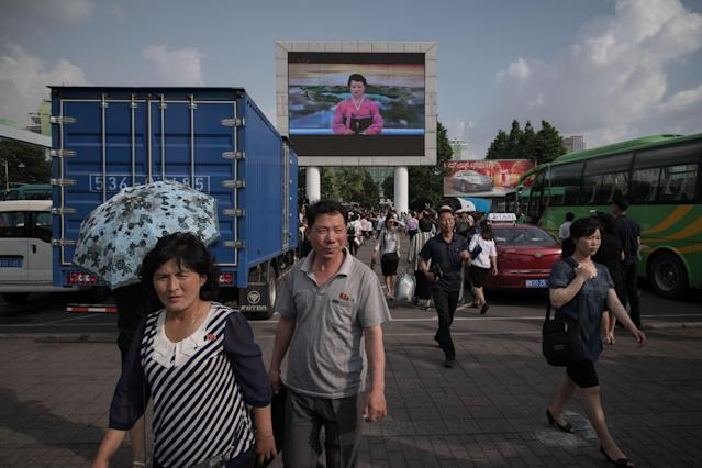 <p>In Pyongyang, a news bulletin on an outdoor television screen highlights the trip to Singapore by North Korean leader Kim Jong Un, but not his meeting with President Trump. (Photo: Ed Jones/AFP/Getty Images) </p>