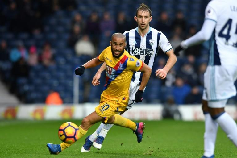 Crystal Palace's Andros Townsend runs with the ball during their English Premier League football match against West Bromwich Albion in West Bromwich, central England, on March 4, 2017 Crystal Palace won the game 2-0