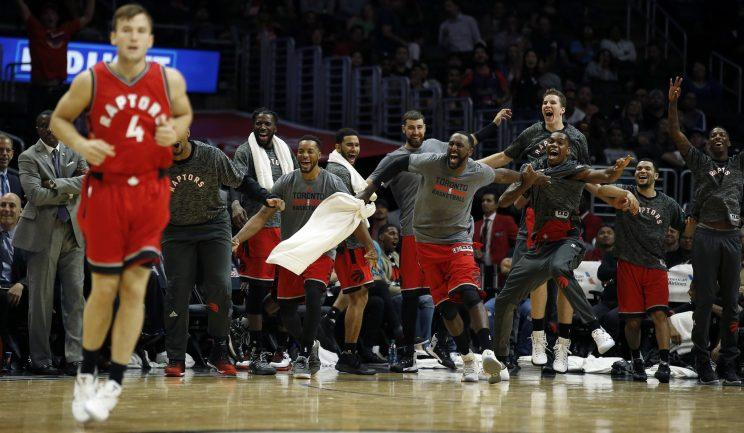 From the looks of it, the Raptors bench might agree with Jerry Stackhouse's assessment of Brady Heslip (4). (AP)