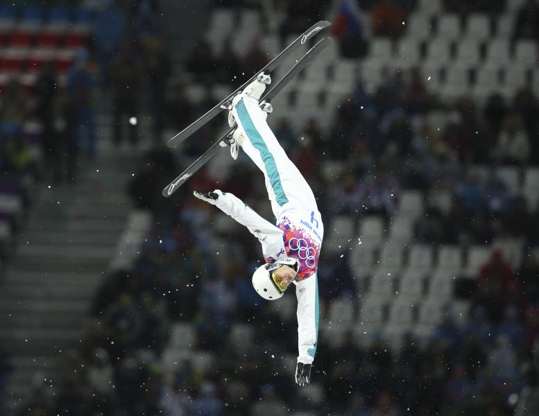 Australia's Lydia Lassila makes her bronze medal-winning jump during the women's freestyle skiing aerials final at the Rosa Khutor Extreme Park, at the 2014 Winter Olympics, Friday, Feb. 14, 2014, in Krasnaya Polyana, Russia. (AP Photo/Sergei Grits)