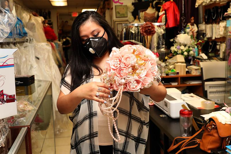 Jessica Larios, owner of Bella's Events, which specializes in rentals and sales of anything party related, with a Quinceanera bouquet at the shop in Yonkers May 28, 2020. The Acceleration Project, a Scarsdale nonprofit consulting firm that is helping small businesses survive during the pandemic helped Larios navigate the loans process and adapt her business by moving it online.
