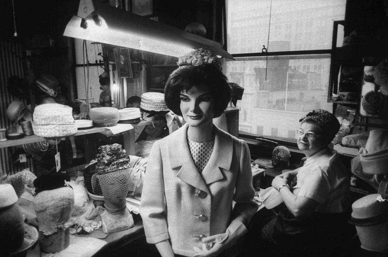 Mannequin of Jackie Kennedy, a standard size 10, stands at John Frederics shop in New York where pillbox hats sell for $35 to $70.