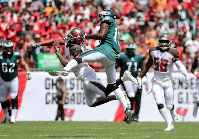 <p>Tampa Bay Buccaneers cornerback Carlton Davis (33) breaks up Philadelphia Eagles wide receiver Nelson Agholor (13) pass during the first quarter at Raymond James Stadium. Mandatory Credit: Kim Klement-USA TODAY Sports </p>