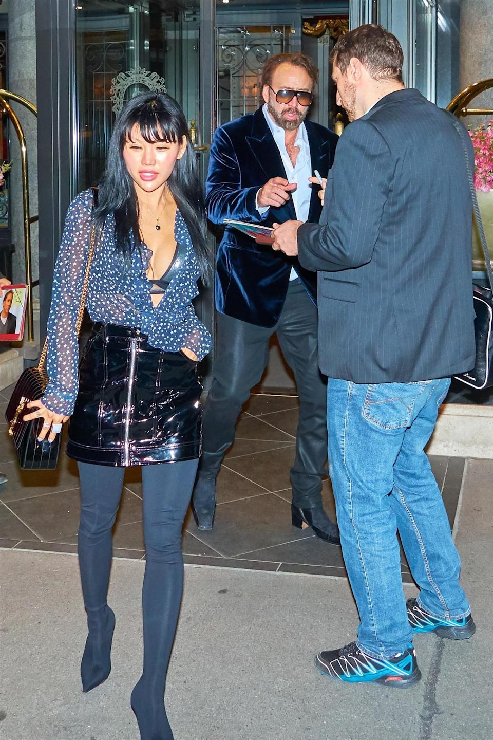 Nicolas Cage and a woman identified as Vickie Park in Vienna last month. (Photo: Backgrid)