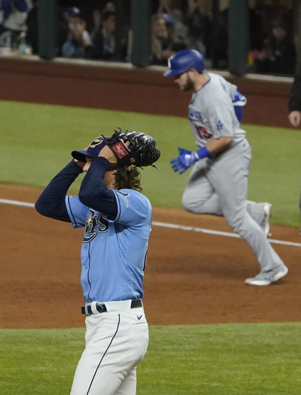 Los Angeles Dodgers first baseman Max Muncy celebrates a home run off Tampa Bay Rays starting pitcher Tyler Glasnow during the fifth inning in Game 5 of the baseball World Series Sunday, Oct. 25, 2020, in Arlington, Texas. (AP Photo/Tony Gutierrez)