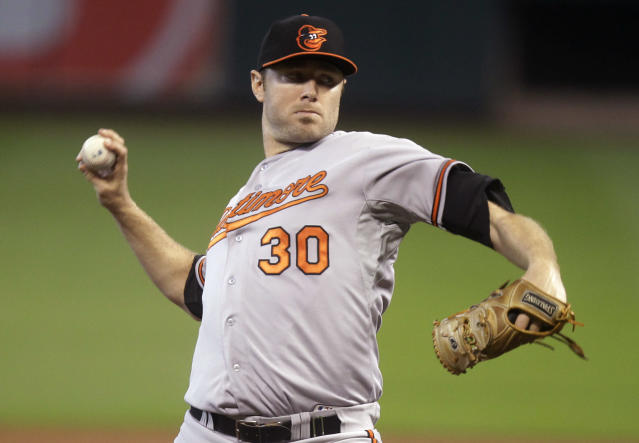 Baltimore Orioles pitcher Chris Tillman throws during the first inning of a baseball game against the Houston Astros, Saturday, May 31, 2014, in Houston. (AP Photo/Patric Schneider)
