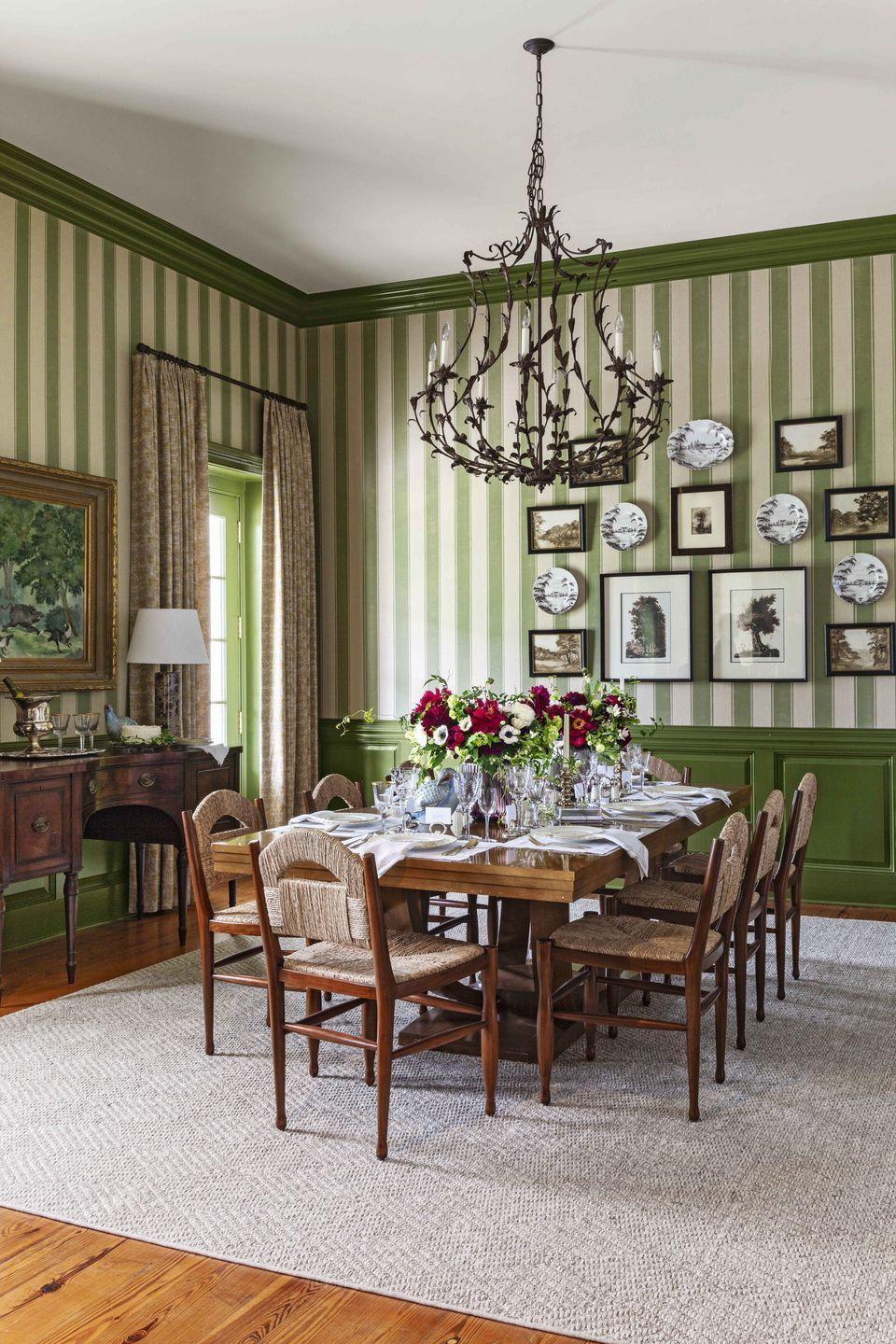<p>Here, designer Andrew Howard utilizes a grasscloth wallpaper in a vertical stripe for a dining room in a South Carolina hunting lodge. This textured grass cloth covering makes an excellent backdrop for framed landscapes and a set of serveware with bucolic designs and pairs well with matching trim.<br></p>