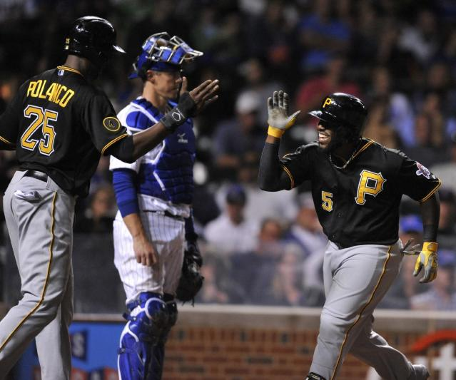Pittsburgh Pirates' Josh Harrison (5) celebrates with teammate Gregory Polanco (25) at home plate after hitting a two-run home run during the seventh inning of a baseball game against the Chicago Cubs in Chicago, Saturday, June 21, 2014. (AP Photo/Paul Beaty)