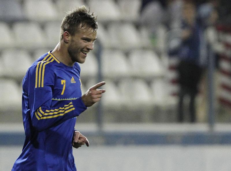 Andriy Yarmolenko of Ukraine celebrates his goal against U.S. during an international friendly match at Antonis Papadopoulos stadium in southern city of Larnaca, Cyprus, Wednesday, March 5, 2014. The Ukrainians are facing the United States in a friendly in Cyprus, a match moved from Kharkiv, Ukraine, to Larnaca for security reasons. (AP Photo/Petros Karadjias)