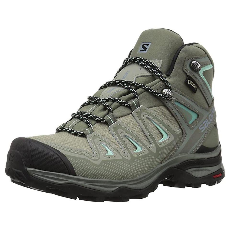"<p><strong>Salomon</strong></p><p>amazon.com</p><p><strong>$164.95</strong></p><p><a href=""https://www.amazon.com/dp/B073K3R1CW?tag=syn-yahoo-20&ascsubtag=%5Bartid%7C2141.g.19791835%5Bsrc%7Cyahoo-us"" rel=""nofollow noopener"" target=""_blank"" data-ylk=""slk:SHOP NOW"" class=""link rapid-noclick-resp"">SHOP NOW</a></p><p>Made with waterproof GORE-TEX protection, these over-the-ankle boots are your new go-to for hikes near running water or snowy mountain climbs. <strong>Shock-absorbing EVA foam lends an ultra-comfy feel</strong>, especially combined with an OrthoLite insole. ""It was as if I'd had them for years, they were so comfortable,"" one Amazon reviewer writes. ""We've had a lot of rain lately and I didn't even notice the soggy ground, and while walking through a few light streams, my feet stayed completely dry.""</p>"