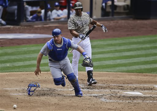 Los Angeles Dodgers catcher Tim Federowicz chases down a wild pitch as a San Diego Padres' baserunner advances during the second inning of a baseball game in San Diego, Sunday, June 23, 2013. The Padres batter is Jesus Guzman. (AP Photo/Lenny Ignelzi)