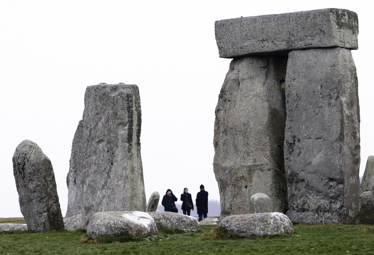 Visitors look at Stonehenge in southwest England, December 21, 2009. The Winter Solstice  falls today, December 21. REUTERS/Suzanne Plunkett