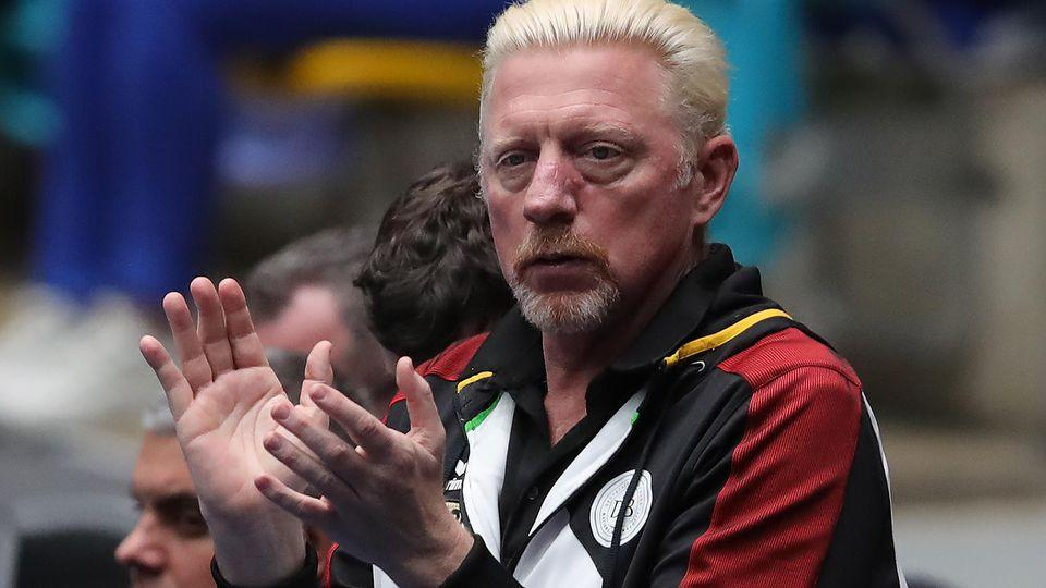Boris Becker is pictured here clapping during a tennis match.