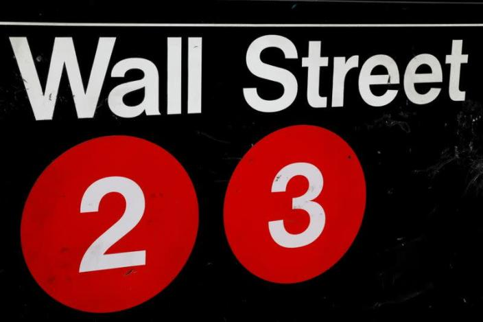 FILE PHOTO: A sign for the Wall Street subway station is seen in the financial district in New York