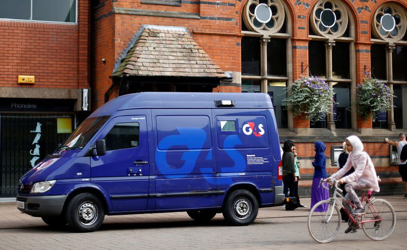 FILE PHOTO: A G4S security van is parked outside a bank in Loughborough