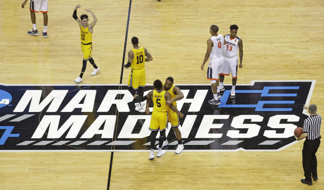 UMBC players celebrate their 74-54 win over Virginia in a first-round game in the NCAA men's college basketball tournament in Charlotte, N.C., Friday, March 16, 2018. (AP Photo/Chuck Burton)
