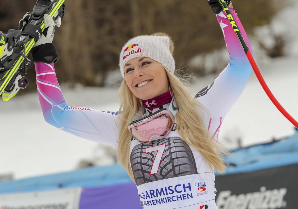 Lindsey Vonn of the US celebrates after winning the Ladies' Downhill event at the FIS Alpine Skiing World Cup in Garmisch-Partenkirchen, southern Germany on February 4, 2018