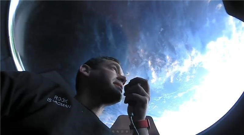 Inspiration4 Jared Isaacman inside the SpaceX Crew Dragon viewing  cupola at the spacecraft orbits the Earth.