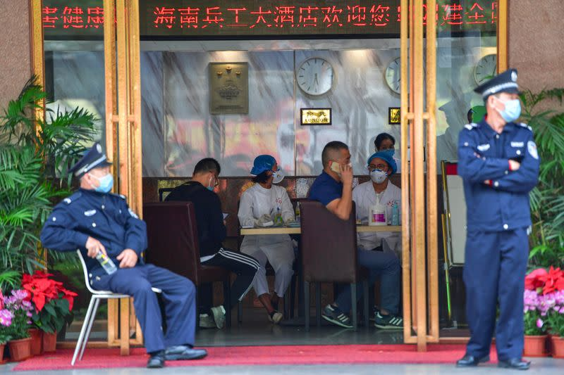 Medical staff are seen at a hotel lobby where tourists from Hubei province, the centre of the coronavirus outbreak, will have 14-day centralised medical observation, in Haikou, Hainan