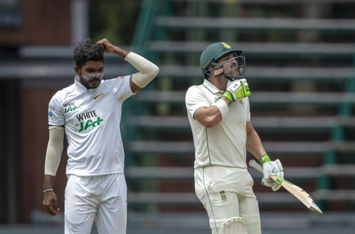 South Africa's batsman Dean Elgar, right, celebrates scoring winning run off Sri Lanka's bowler Wanindu Hasaranga during play on the third day of the second cricket test match between South Africa and Sri Lanka at Wanderers stadium in Johannesburg, South Africa, Tuesday, Jan. 5, 2021. South Africa beat Sri Lanka by 10 wickets. (AP Photo/Themba Hadebe)