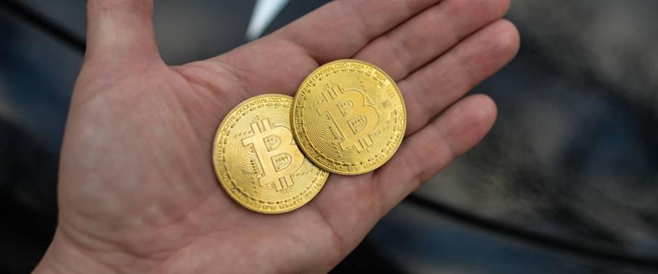 Man holding bitcoin in his hand, open palm