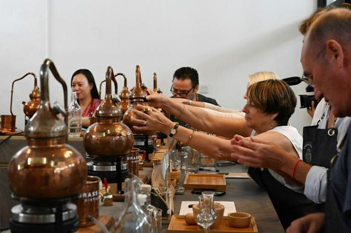 Using their own, small copper still, students at this Singapore gin school start with a neutral base spirit and redistill it with their custom mix of botanicals, then add water to the end product to reach the desired alcohol level (AFP Photo/Roslan RAHMAN)