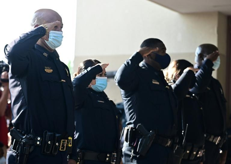 The police salute as the casket with George Floyd arrives at The Fountain of Praise church where services were held for George Floyd on June 9, 2020 in Houston, Texas (AFP Photo/Johannes EISELE)