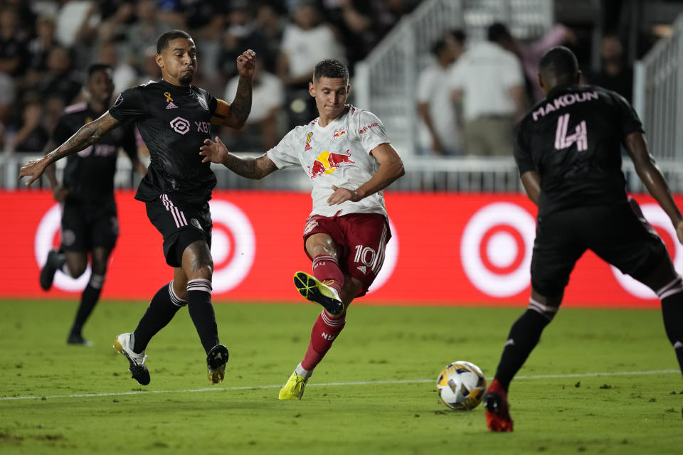 New York Red Bulls forward Patryk Klimala shoots while defended by Inter Miami midfielder Gregore Silva, left, and defender Christian Makoun during the first half of an MLS soccer match Friday, Sept. 17, 2021, in Fort Lauderdale, Fla. (AP Photo/Rebecca Blackwell)