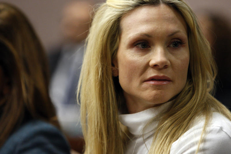 "FILE - This Nov. 27, 2012 file photo shows former ""Melrose Place"" actress Amy Locane-Bovenizer in court as the jury in her trial returns a verdict in Somerville, N.J. Locane-Bovenizer, who was driving drunk when her SUV plowed into a car and killed a New Jersey woman, was sentenced Thursday, Feb. 14, 2013, to three years in prison. (AP Photo/The Star-Ledger, Robert Sciarrino, Pool)"