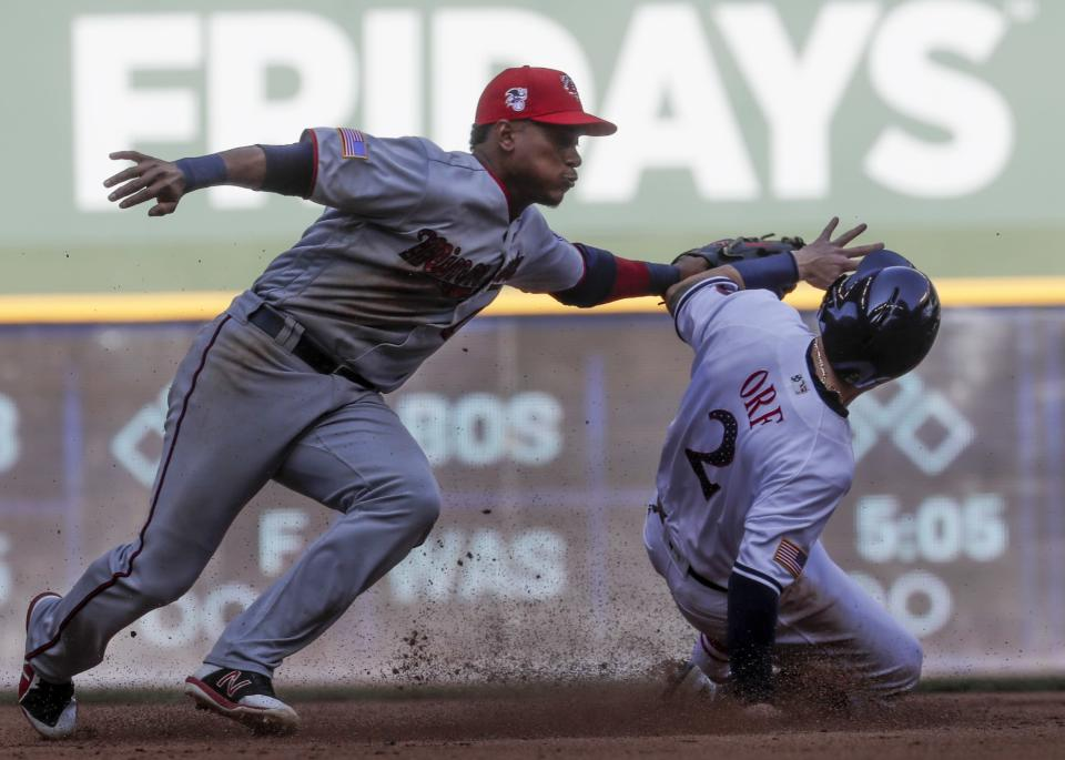 Milwaukee Brewers' Nate Orf steals second with Minnesota Twins' Jorge Polanco covering during the fifth inning of a baseball game Tuesday, July 3, 2018, in Milwaukee. (AP Photo/Morry Gash)