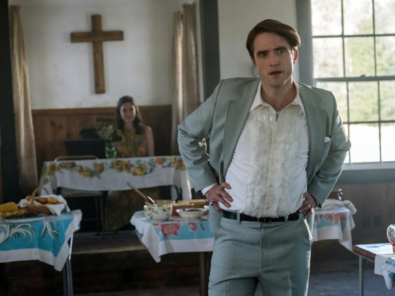 Robert Pattinson (right) revels in the role of Reverend Preston TeagardinNetflix