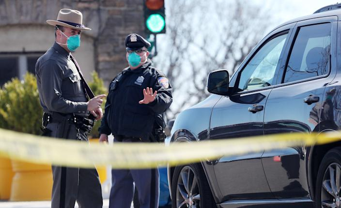 New York State Police and Westchester County Police stop cars at the entrance to Glen Island Park in New Rochelle March 14, 2020. The park is the location for mobile testing of the Coronavirus.