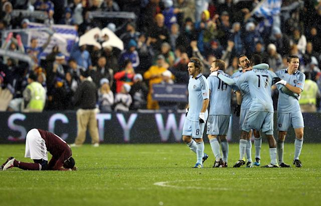 KANSAS CITY, KS - NOVEMBER 02: Players celebrate after the final whistle as Sporting Kansas City defeats the Colorado Rapids 2-0 to win the MLS playoff game on November 2, 2011 at LiveStrong Sporting Park in Kansas City, Kansas. (Photo by Jamie Squire/Getty Images)
