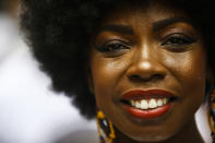 Egili Oliveira, a member of the Mocidade Unida do Santa Marta samba school, smiles for a portrait as she attends a ceremony marking Black Consciousness Day in the Santa Marta favela of Rio de Janeiro, Brazil, Friday, Nov. 20, 2020. Brazilians celebrate the holiday with Afro-Brazilian dance, music and religious ceremonies, reflecting the deep cultural and social ties of the Black community to the country's history and honor legendary anti-slave leader Zumbi dos Palmares on the day of his death. (AP Photo/Bruna Prado)
