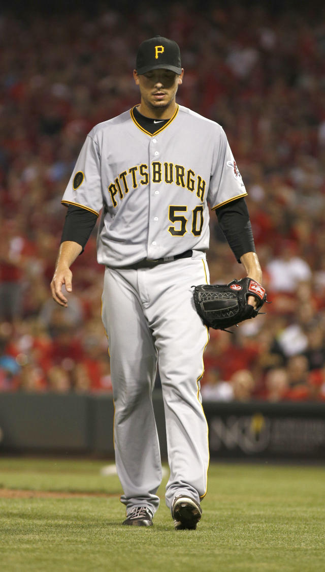 Pittsburgh Pirates starting pitcher Charlie Morton walks off the field at the end of the sixth inning of a baseball game against the Cincinnati Reds, Saturday, July 12, 2014, in Cincinnati. (AP Photo/David Kohl)