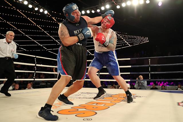 <p>Robert Marzano (red) fights Jafet Sori (blue) in the TD1 ATU Grudge Match at the NYPD Boxing Championships at the Hulu Theater at Madison Square Garden on March 15, 2018. (Gordon Donovan/Yahoo News) </p>