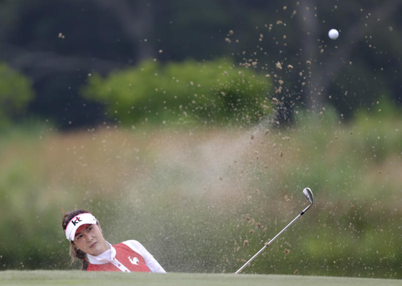 Ha-Neul Kim of South Korea hits out of a bunker near the seventh green during the second round at the U.S. Women's Open golf tournament at Sebonack Golf Club in Southampton, N.Y., Friday, June 28, 2013. (AP Photo/Seth Wenig)