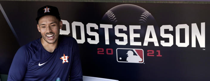 Houston Astros shortstop Carlos Correa smiles as he talks with reporters during a baseball practice Wednesday, Oct. 6, 2021, in Houston. The Astros will host the Chicago White Sox in an American League Division Series game Thursday. (AP Photo/David J. Phillip)