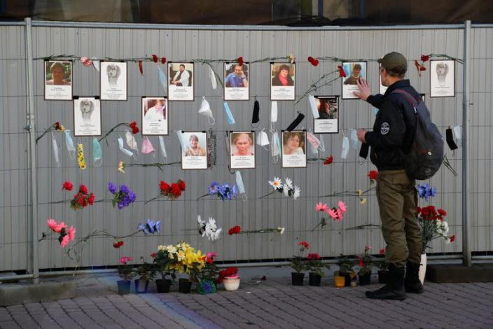 A man visits a makeshift memorial for medics, who reportedly died in Saint Petersburg and Leningrad Region in the times of the coronavirus disease outbreak, in Saint Petersburg