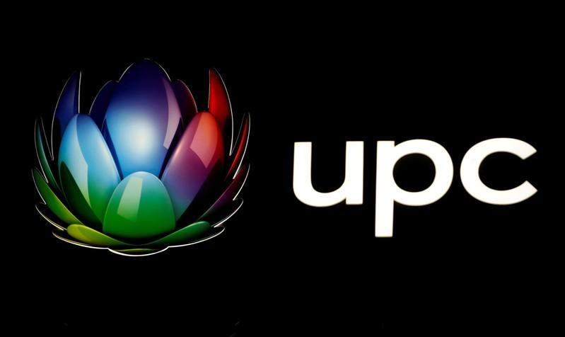 FILE PHOTO: Logo of broadband and telecommunications provider UPC Schweiz is seen at its headquarters in Wallisellen