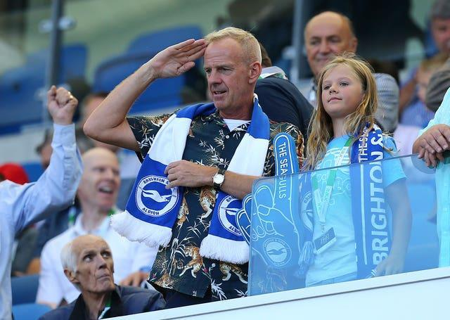 Norman Cook aka Fatboy Slim in the stands at the AMEX Stadium