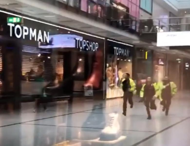 Handout videograb taken with permission from the twitter feed of @GrizzleMarine showing police running through the Arndale Centre in Manchester where at least four people have been treated after a stabbing incident.