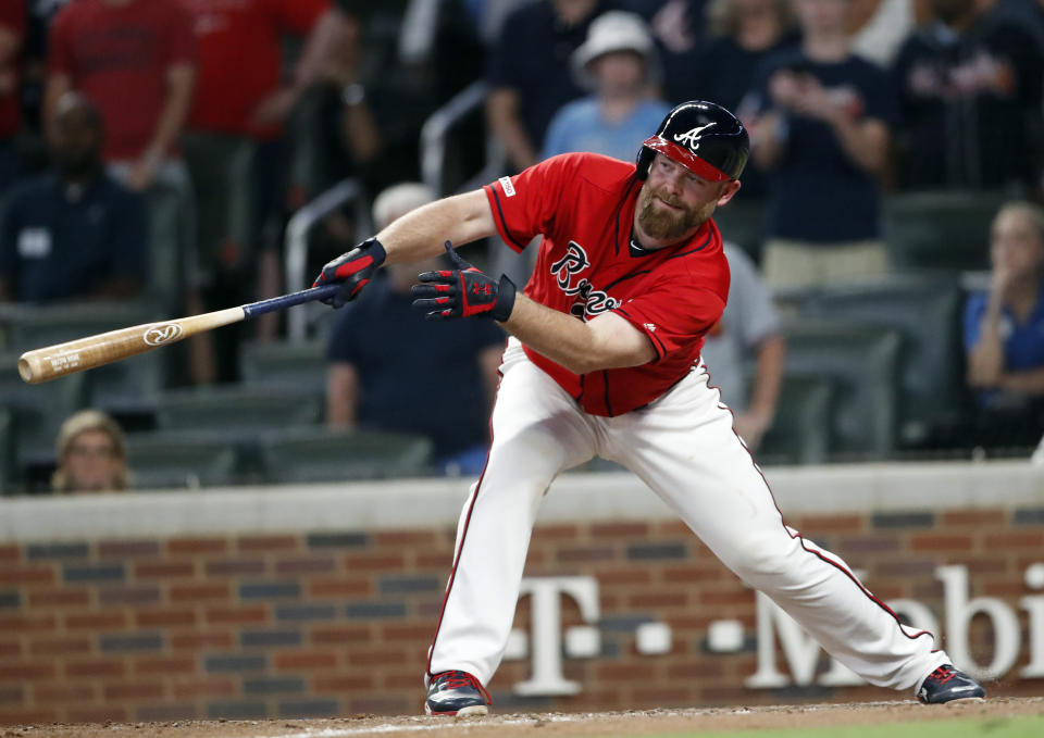 Atlanta Braves' Brian McCann (16) drives in the winning run with a two-run single during the ninth inning of the team's baseball game against the Philadelphia Phillies on Friday, June 14, 2019, in Atlanta. (AP Photo/John Bazemore)