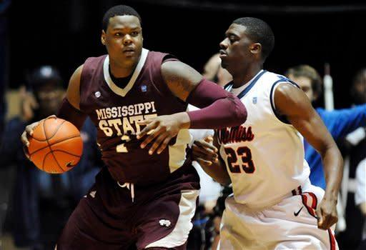 Mississippi State's Renardo Sidney (1) works against Mississippi's Reginald Buckner (23) during an NCAA college basketball game in Oxford, Miss., Wednesday, Jan. 18, 2012. (AP Photo/The Oxford Eagle, Bruce Newman) NO SALES MAGS OUT MANDATORY CREDIT