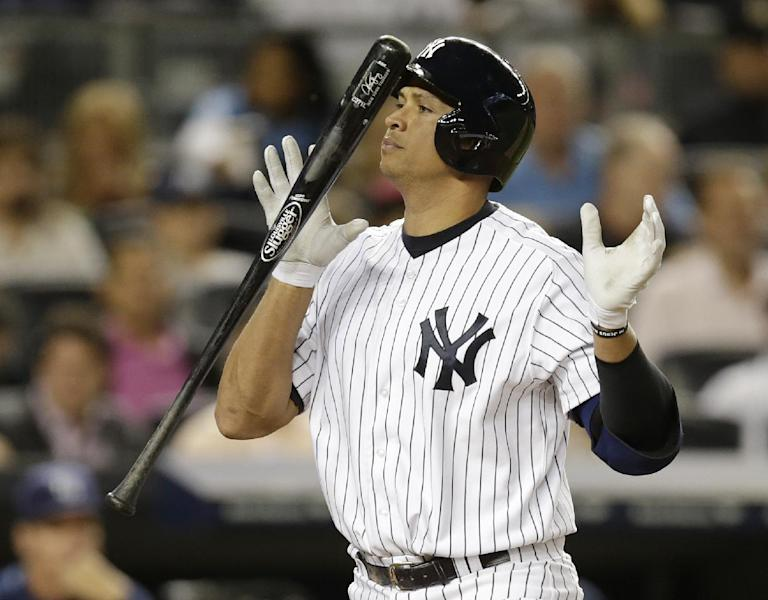 New York Yankees' Alex Rodriguez heads to the dugout after striking out looking in the fifth inning of a baseball game against the Tampa Bay Rays, Wednesday, Sept. 25, 2013, in New York. (AP Photo/Kathy Willens)