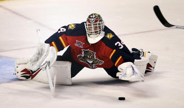 Florida Panthers goalie Tim Thomas stops a New York Rangers' shot during the second period of an NHL hockey game in Sunrise, Fla., Wednesday, Nov. 27, 2013. (AP Photo/J Pat Carter)