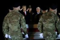 FILE PHOTO: U.S. President Donald Trump salutes the transfer case holding the remains of U.S. Army soldier Sergeant Gutierrez during a dignified transfer at Dover Air Force Base, in Dover, Delaware