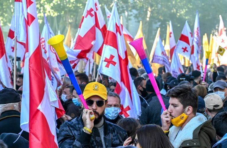 Streets in Tbilisi were a sea of red-and-white flags